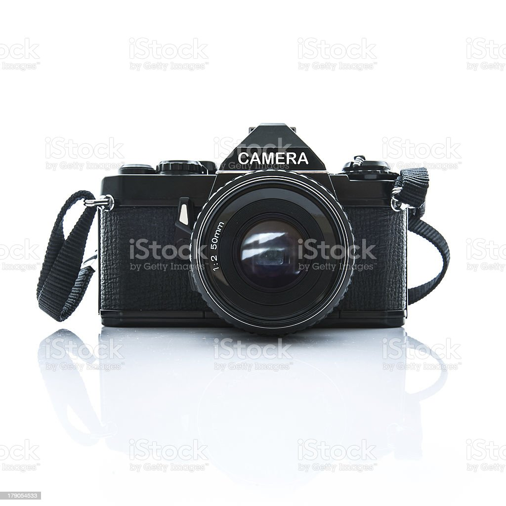 Old SLR Black Camera on White Background royalty-free stock photo