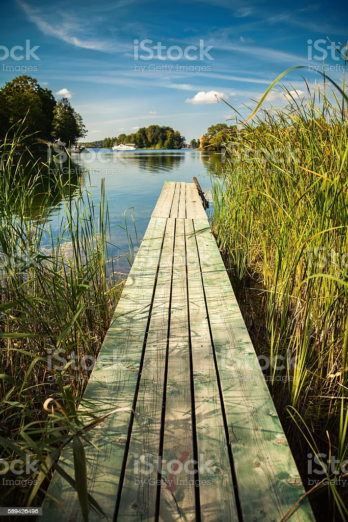 old small pier at the lake Galve in Trakai stock photo