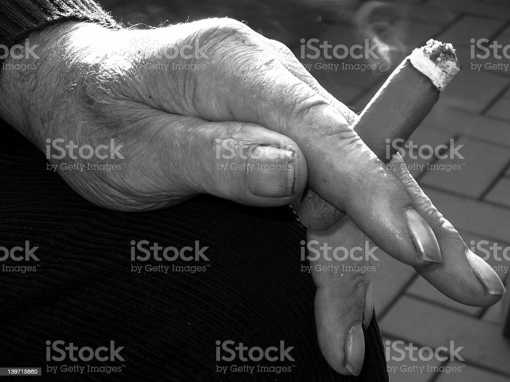 old smoking hand, close up royalty-free stock photo