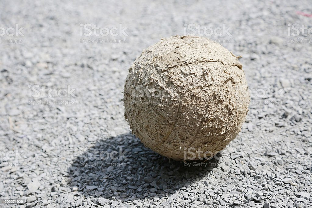 Old soccer ball on the field or stone tablets royalty-free stock photo