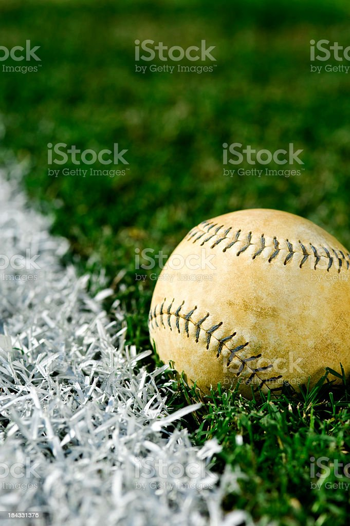 Old Softball  along foul line stock photo