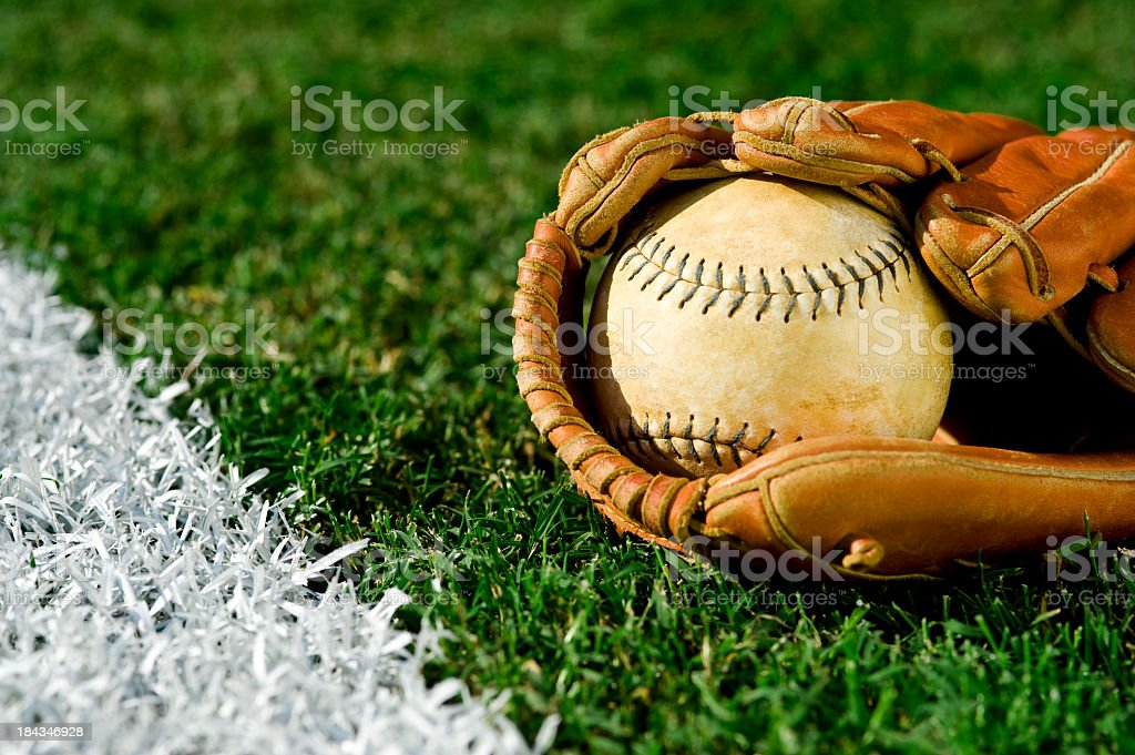 Old Softball  along foul line stock photo