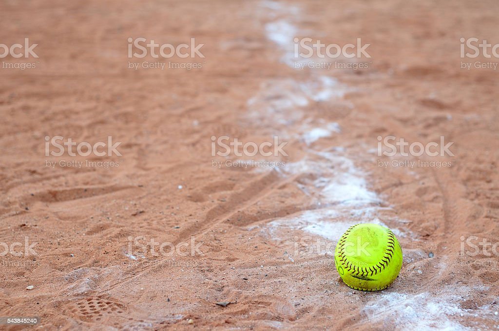 old softball in field stock photo