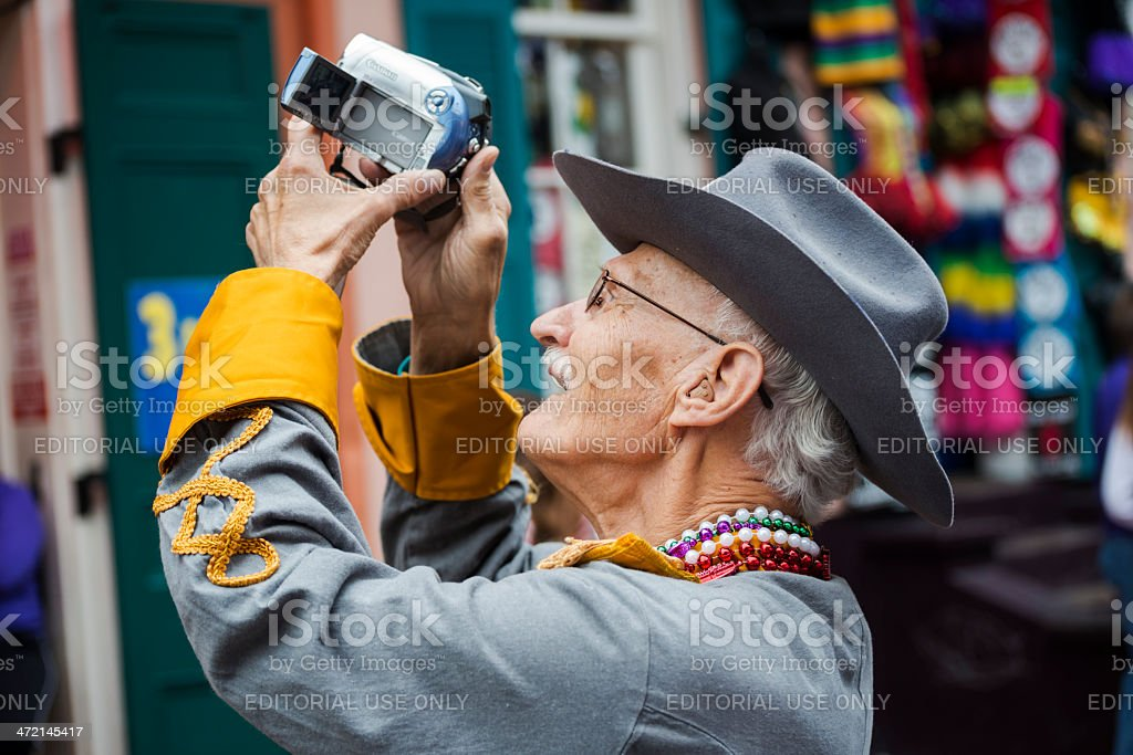 Old Soldier shooting a Canon at Mardi Gras 2013 stock photo