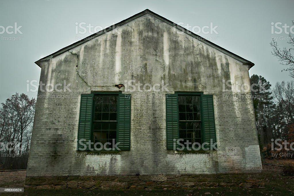 Old South Schoolhouse Church Green Shutter Windows Gloomy Winter Day stock photo