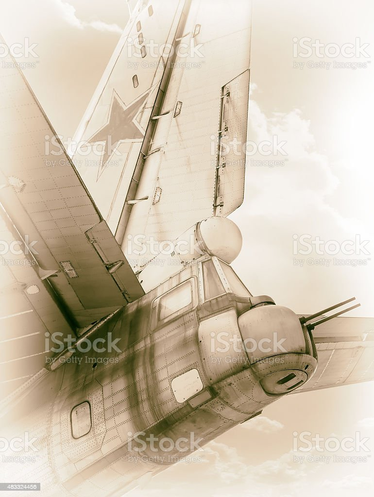 Old Soviet bomber in clouds stock photo