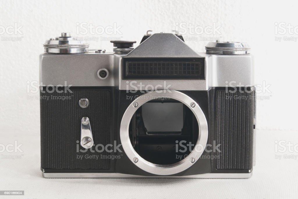 Old Soviet film camera on white background close-up stock photo