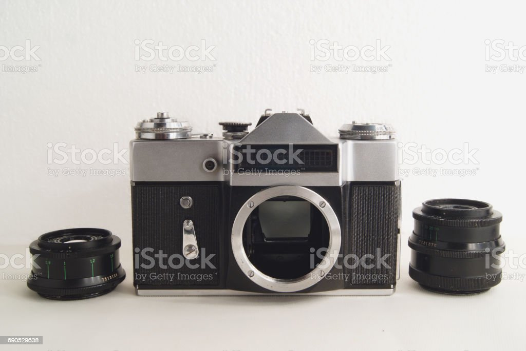 Old Soviet film camera with lens on white background close-up stock photo