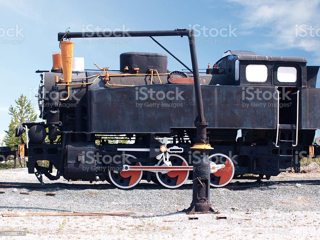 Old soviet locomotive on a background of blue sky stock photo