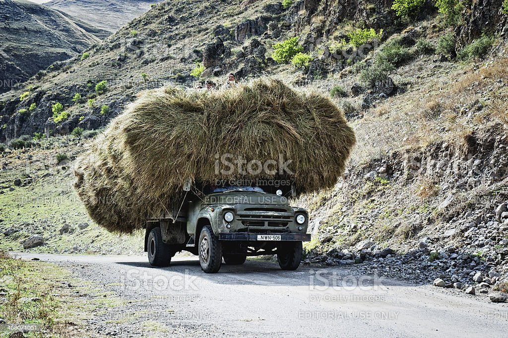 Old soviet truck with hay loaded stock photo