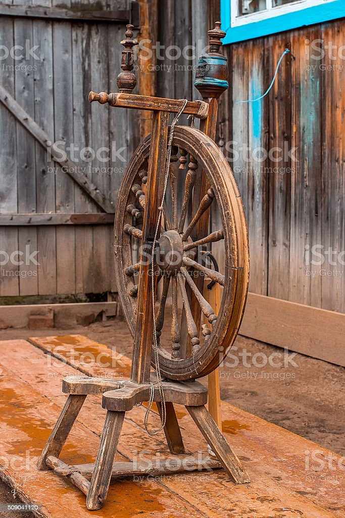 Old spinning wheel. vintage stock photo