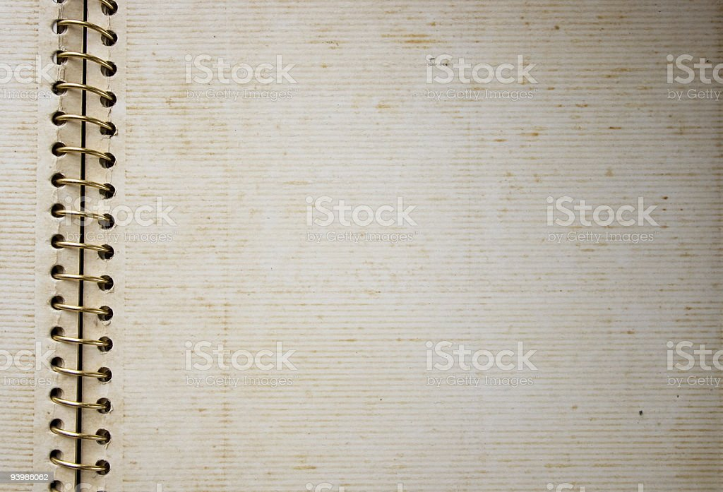Old spiral bind adhesive photo album opened in blank pages stock photo