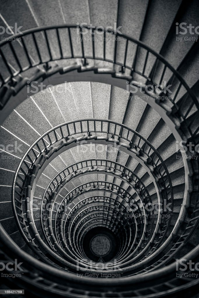 Old spiral stairway from above stock photo