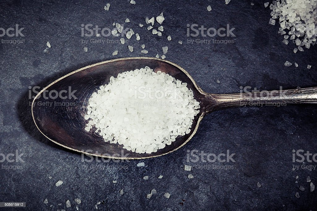 Old spoon rock salt stock photo