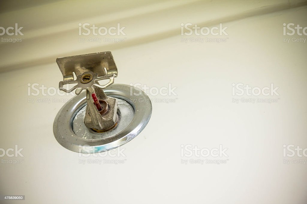 Old sprinkler system on the wall of hotel stock photo