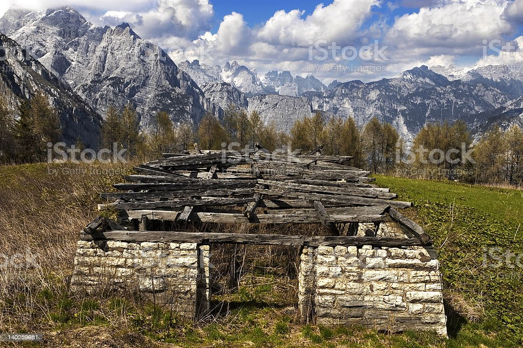 Old stable in the mountain spring day royalty-free stock photo