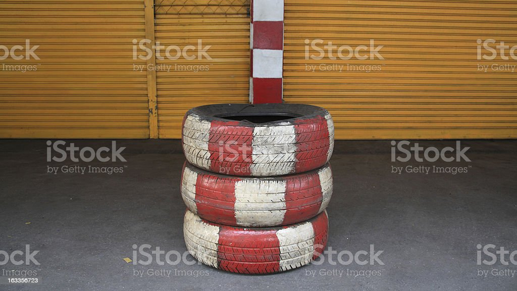 Old stack tires painted by white and red color royalty-free stock photo
