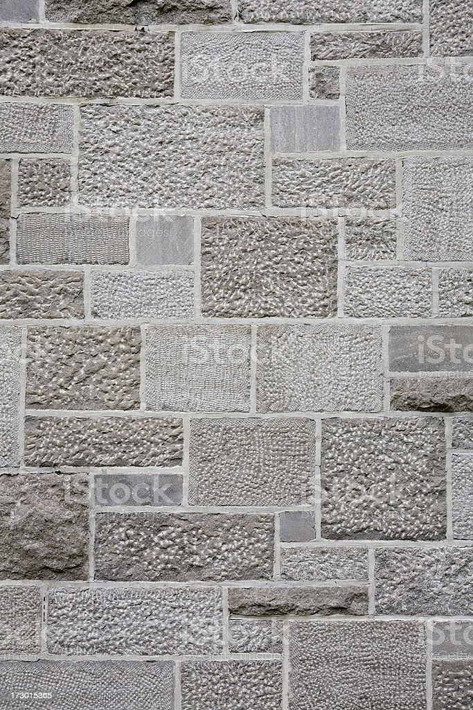 Old stacked stone wall gray background, pattern and texture royalty-free stock photo
