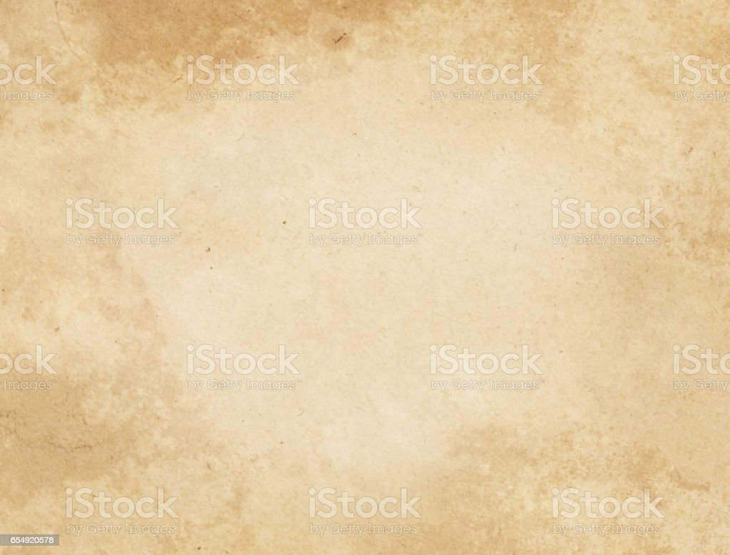 Old stained and yellowed paper texture. stock photo