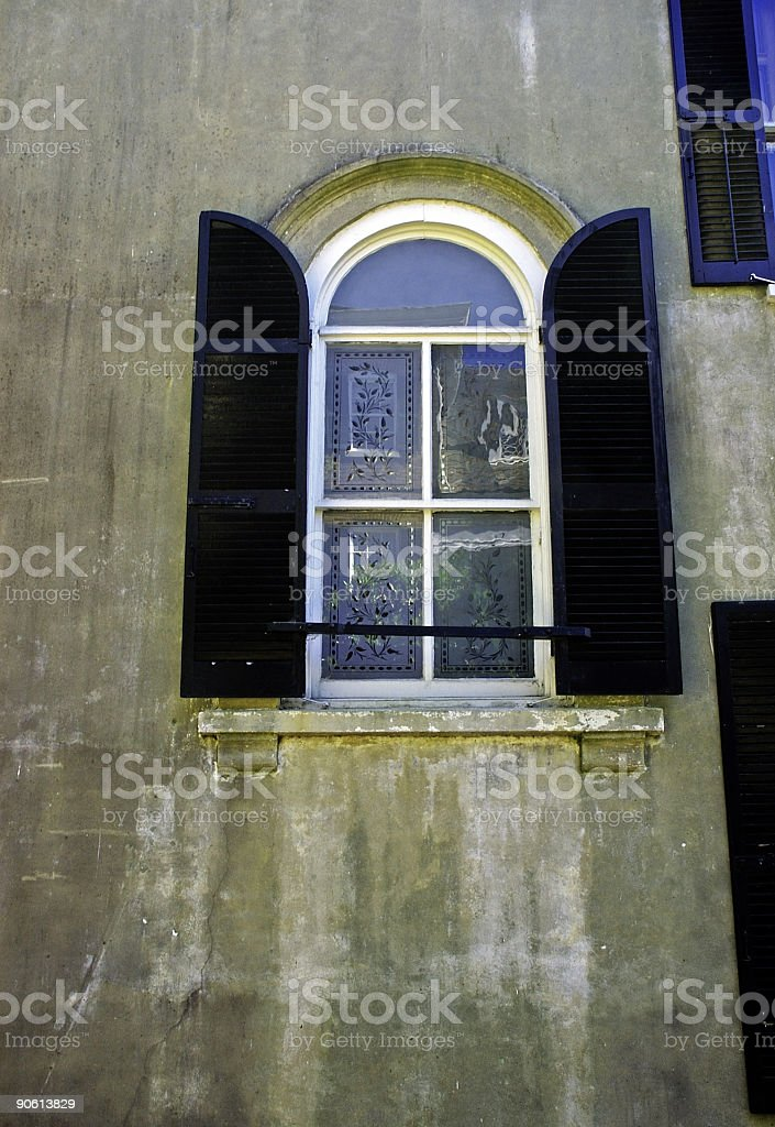 old stained glass window in a historic town royalty-free stock photo