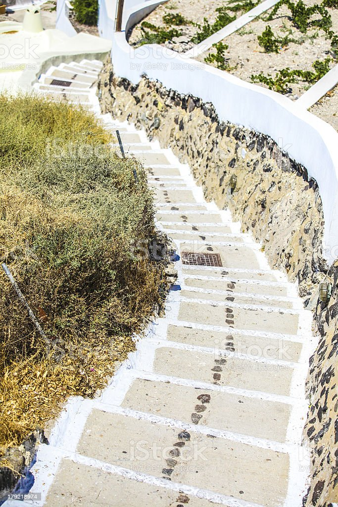 Old staircase and traditional architecture on Santorini in Fira, Greece. stock photo