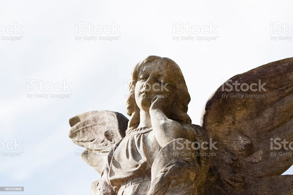 Old statue of angel against sky, copy space stock photo