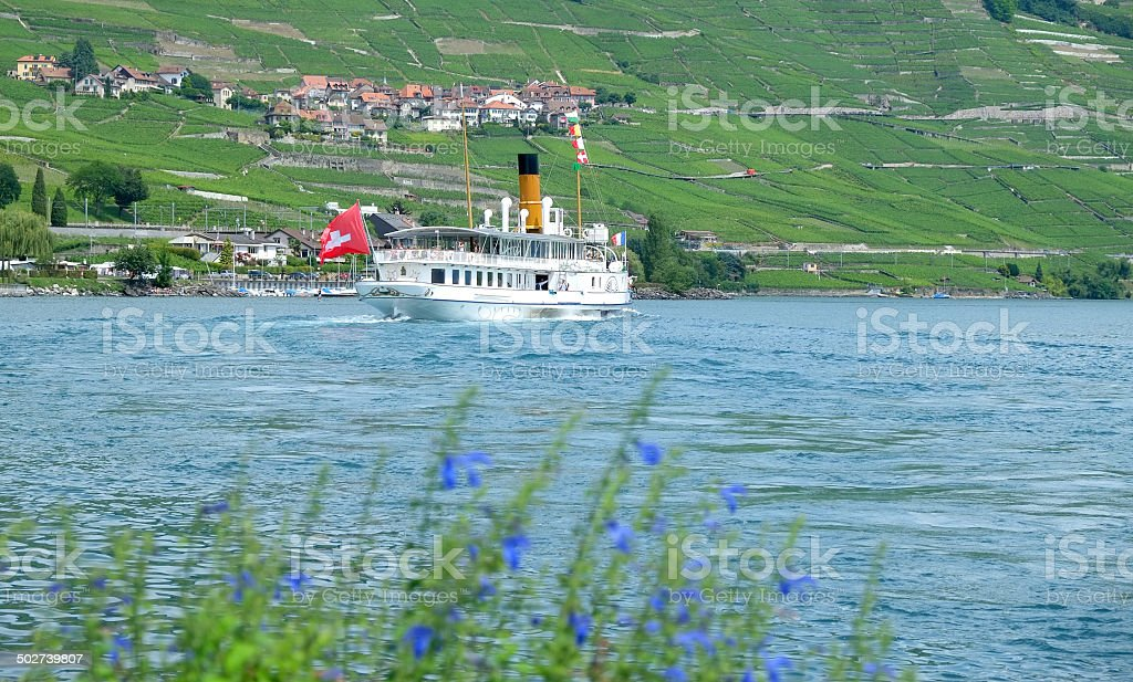 Old steam boat cruising on the Lake Leman stock photo