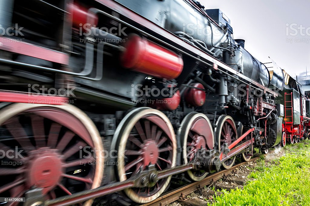 Old steam locomotive on the route stock photo