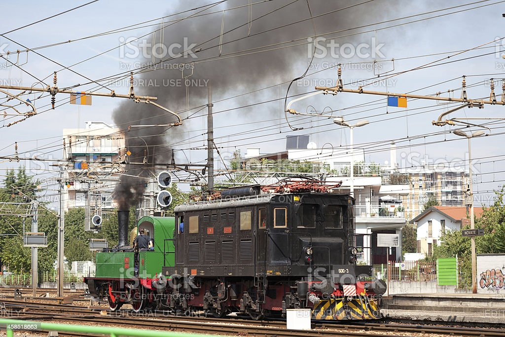 Old steam locomotive running over rails stock photo