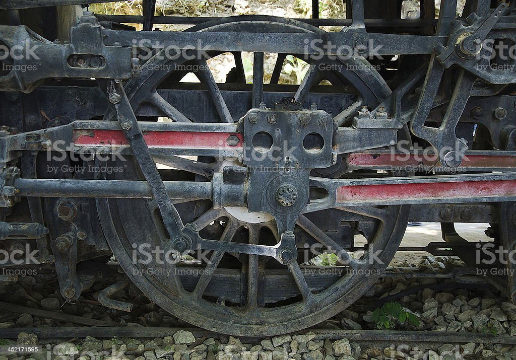 Old steam locomotive wheel and coupling rods royalty-free stock photo