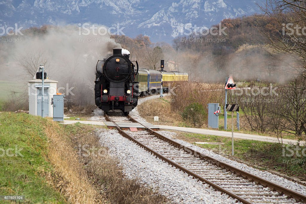 Old steam train, lots of black and gray steam stock photo