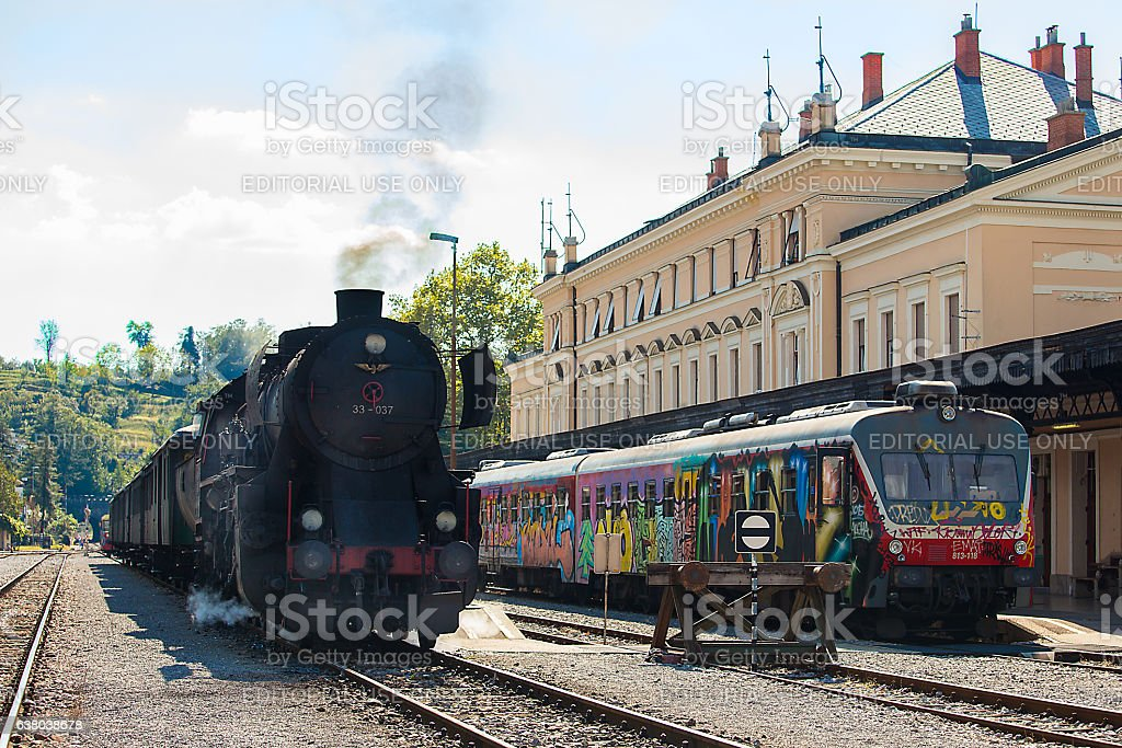 Old steam train near the new diesel train stock photo