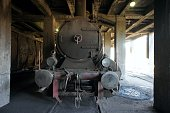 Old steam train pulling into a tunnel