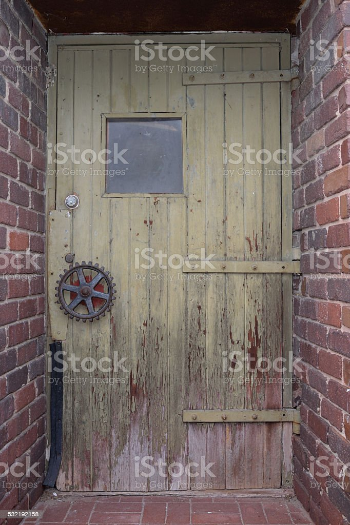 Old Steampunk style entryway with gear handle stock photo