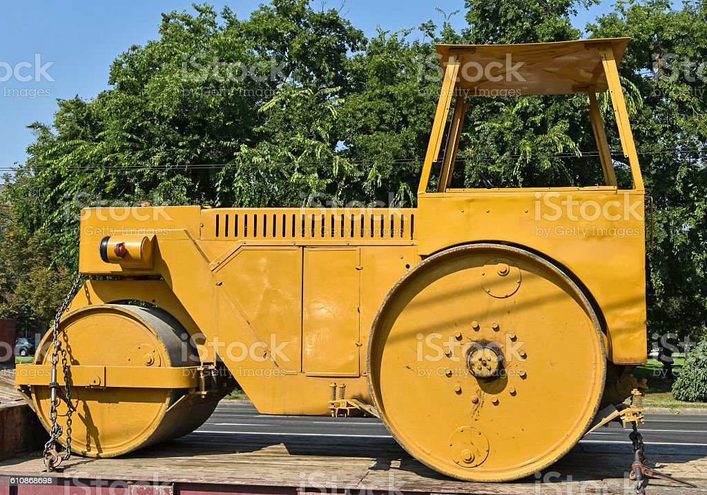 Old steamroller on a trailer stock photo