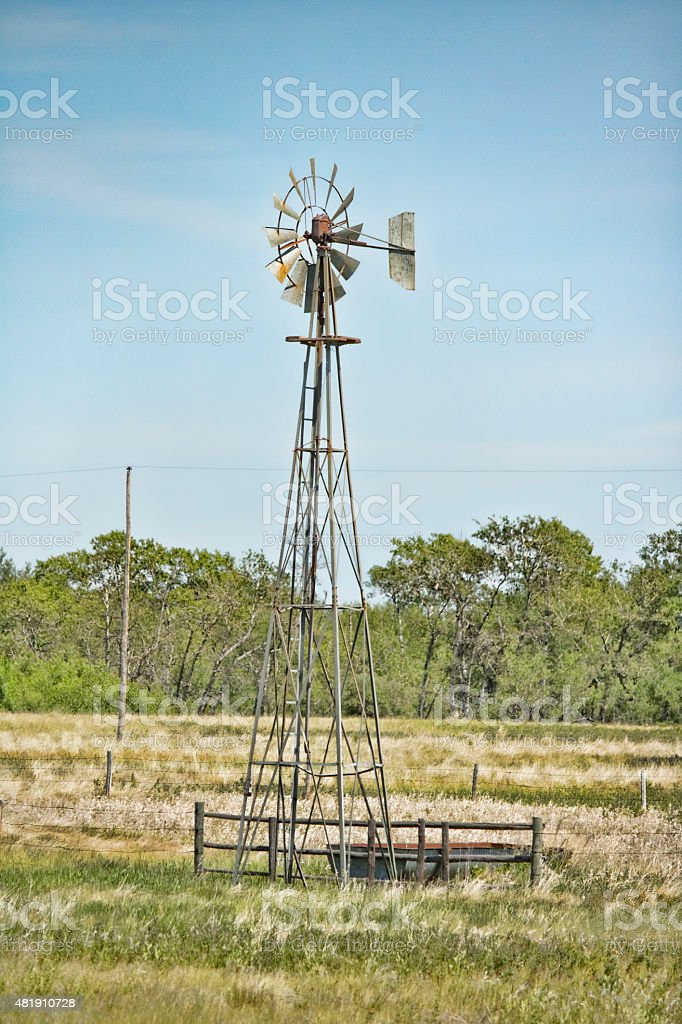 Old Steel Windmill Used to Pump Water For Cattle stock photo