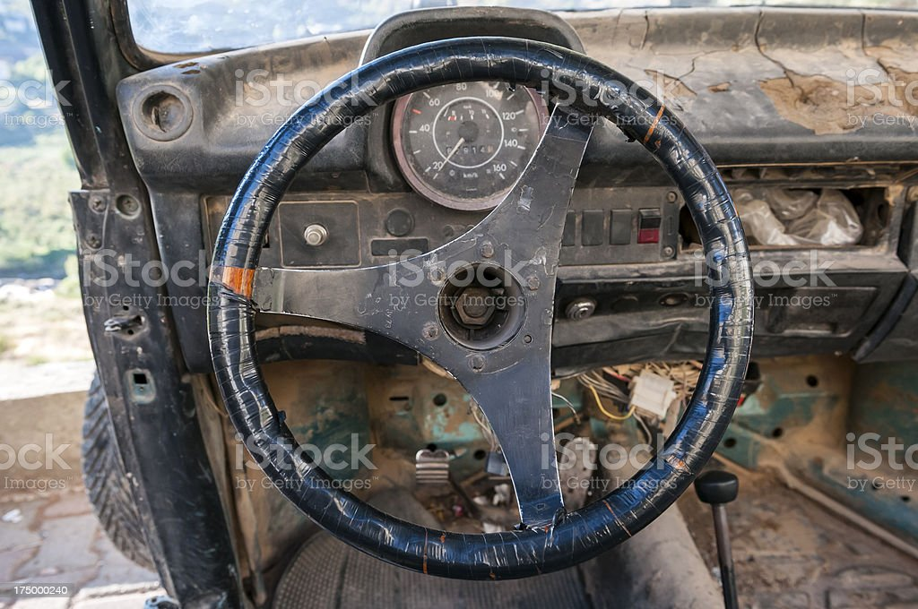 Old steering wheel and car stock photo