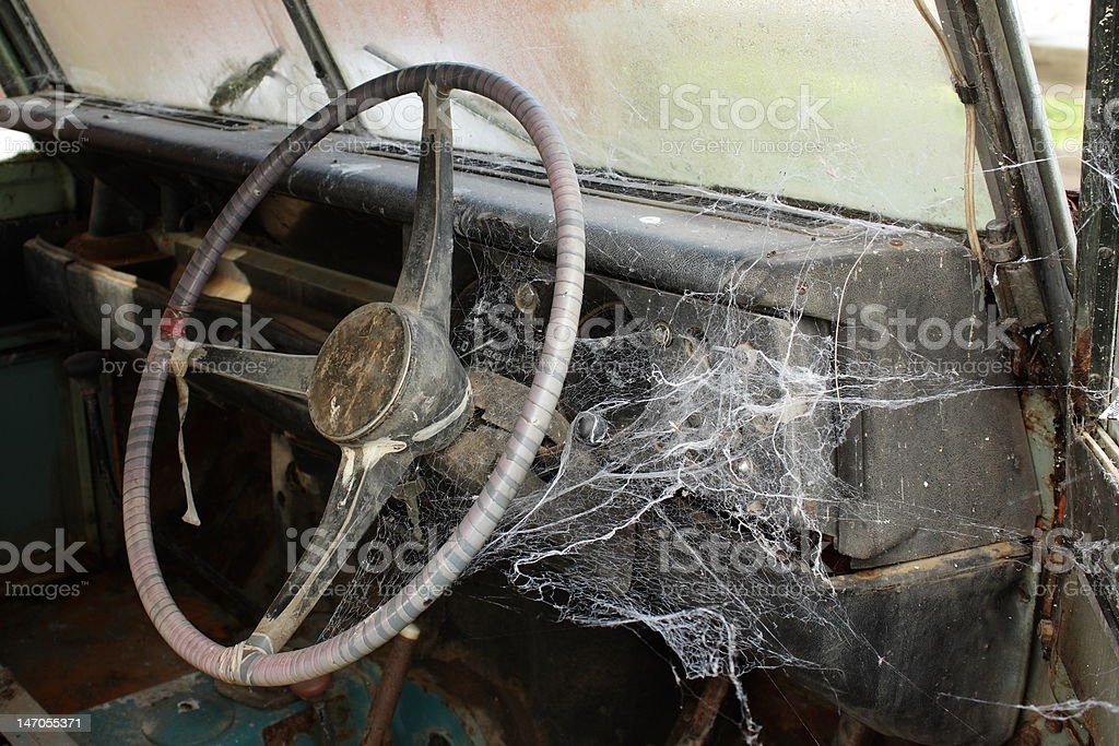 Old Steering Wheel with Spider Webs stock photo