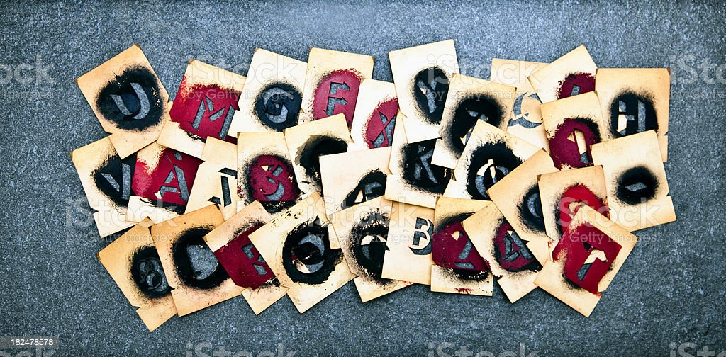Old stencil letter forms stock photo