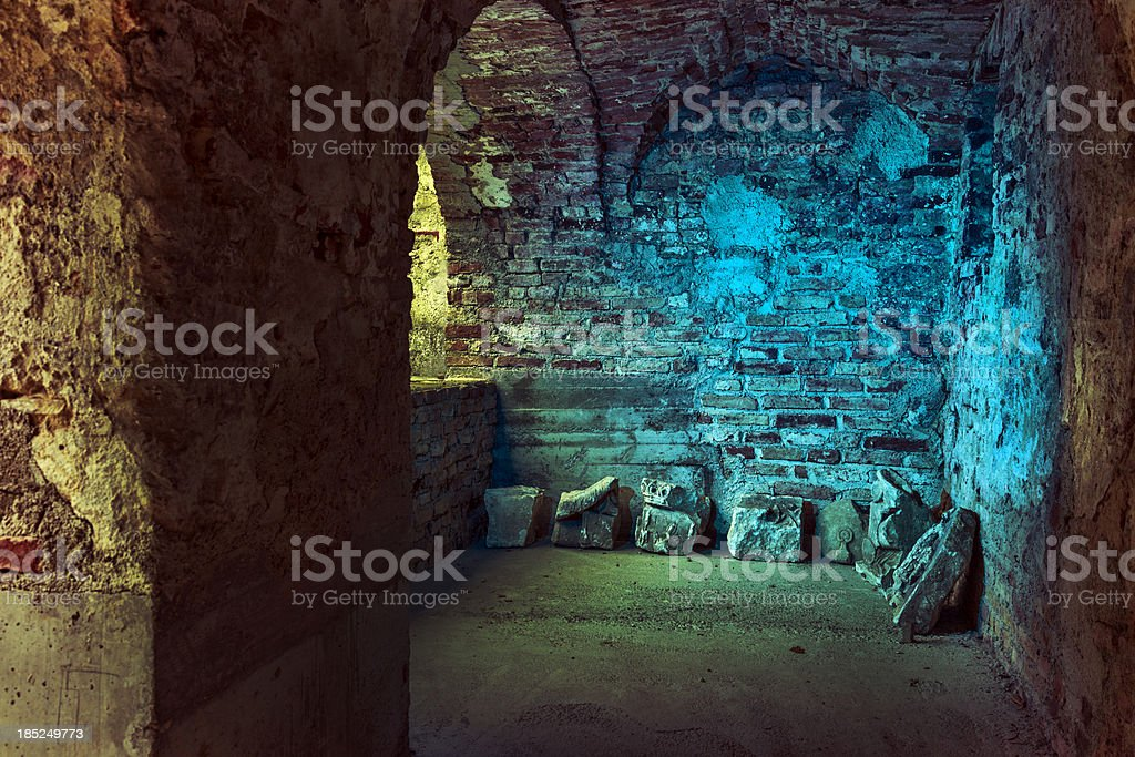 Old stone arcades in a derelict, abandoned castle stock photo
