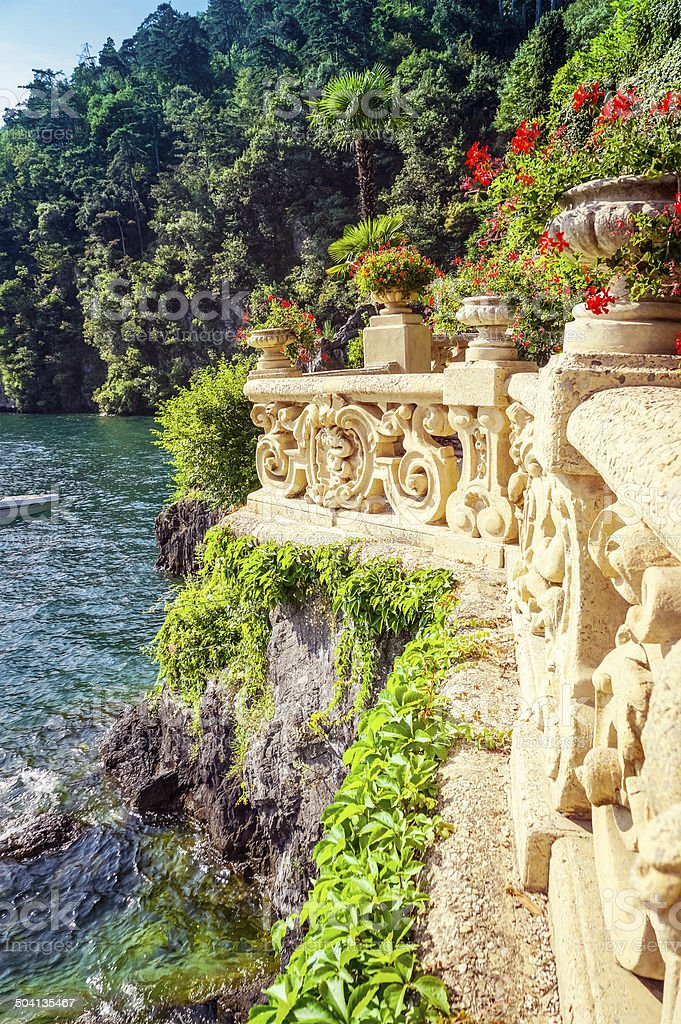 Old stone balcony and pots with flowers, Lake Como, Italy stock photo