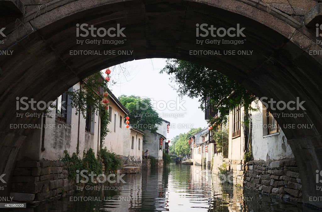 Old stone bridge over canal in Zhouzhuang Water Town stock photo