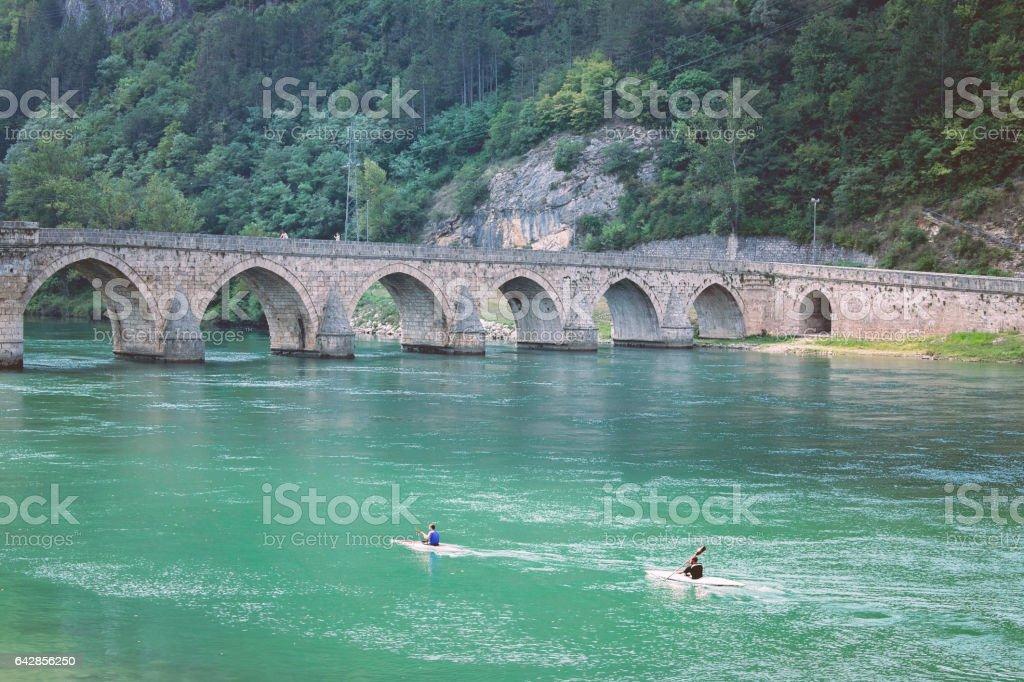 Old stone bridge over Drina river stock photo