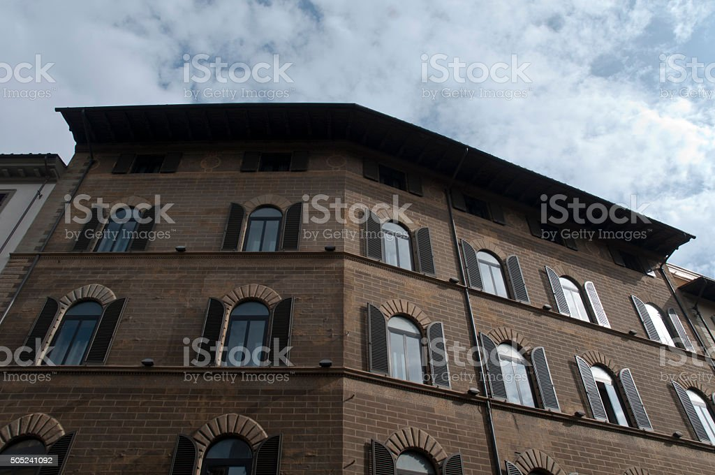 Old stone buildig and fancy windows firenze stock photo