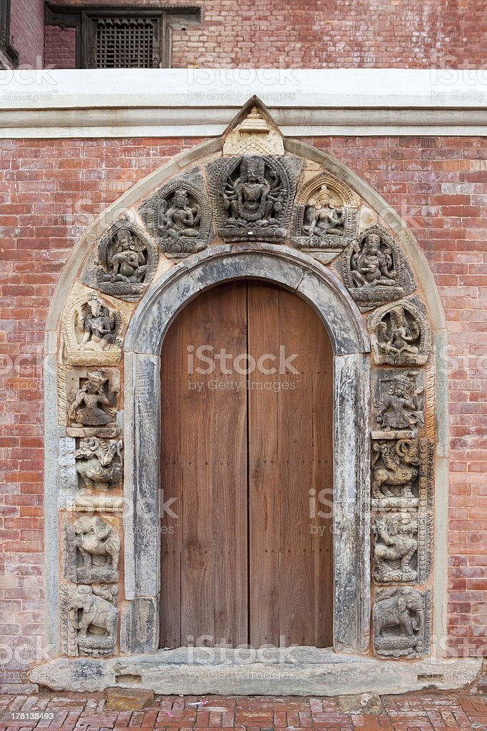 Old Stone carved gate in Patan Durbar Square. stock photo