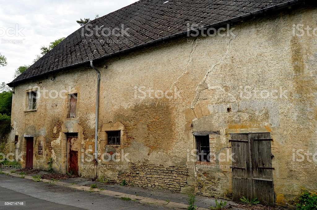 Old stone farm with cowsheds. stock photo