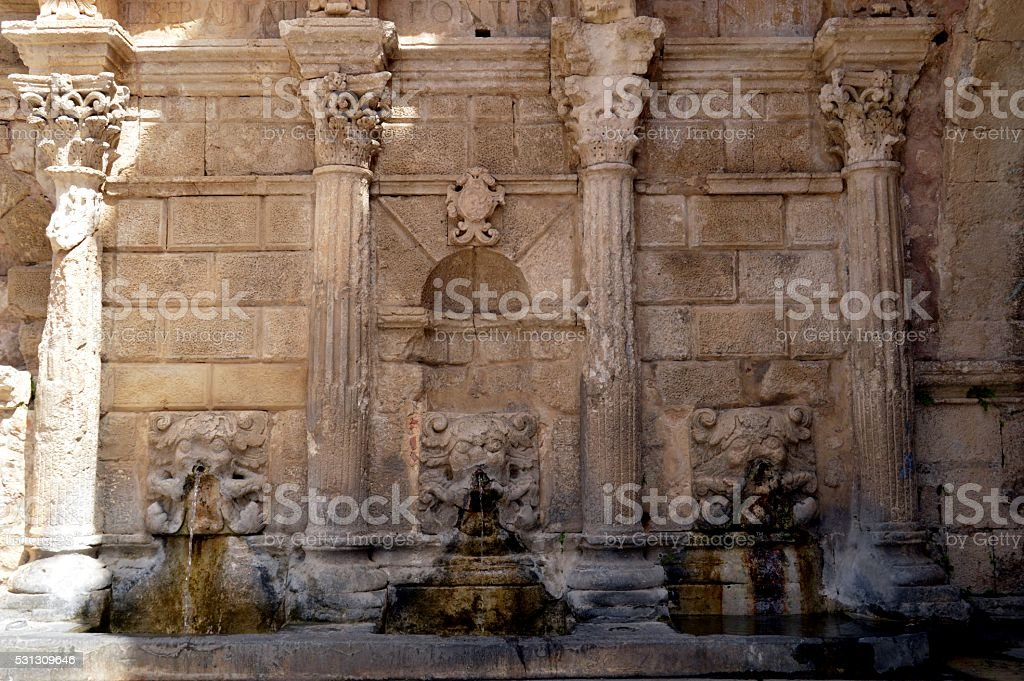 Old stone fountain in the campaign stock photo