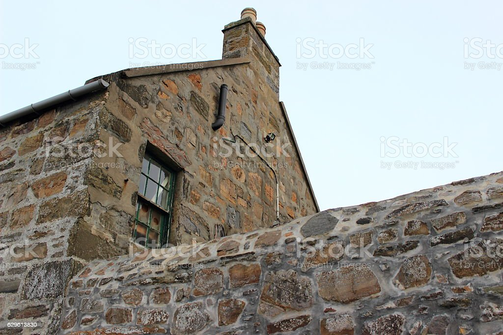 Old Stone House and Stone Wall stock photo