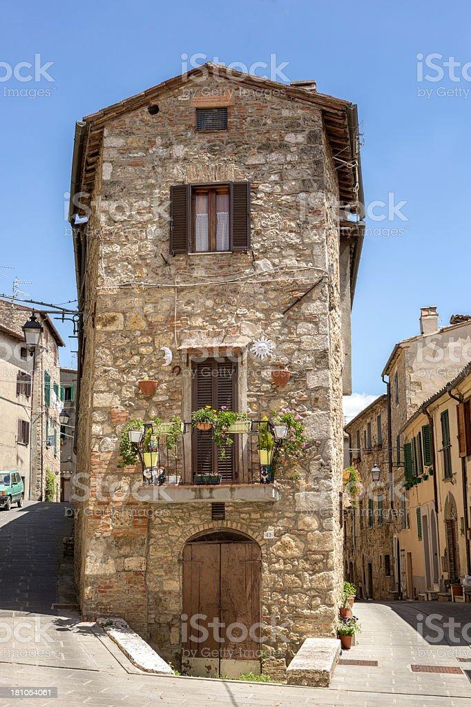 Old stone house in the city Sarteano, Tuscany, Italy stock photo