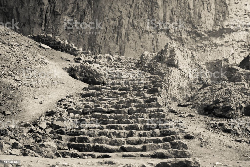 Old stone ladders stock photo
